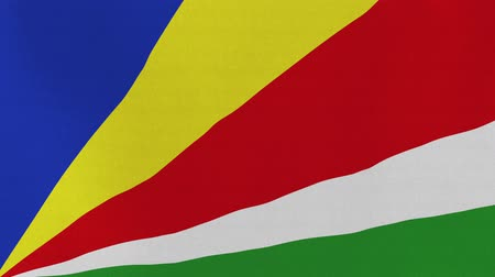 sc : [loopable] Flag of Seychelles.  Seychellois official flag gently waving in the wind. Highly detailed fabric texture for 4K resolution. 15 seconds loop.  Source: CGI rendering.