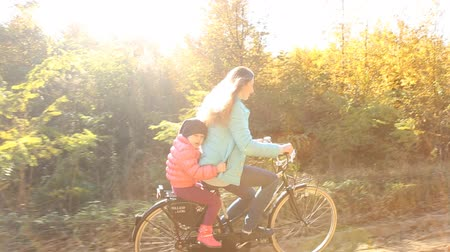 учение : mother with child and the bike in autumn forest