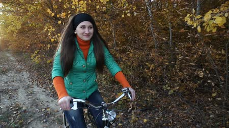 bicycle : Girl with bicycle on nature Stock Footage