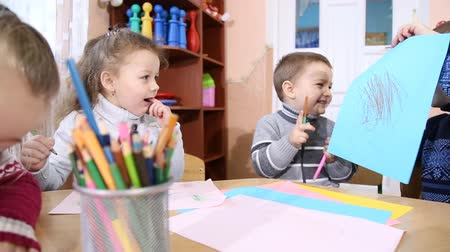 preschool : children draw crayons at the table