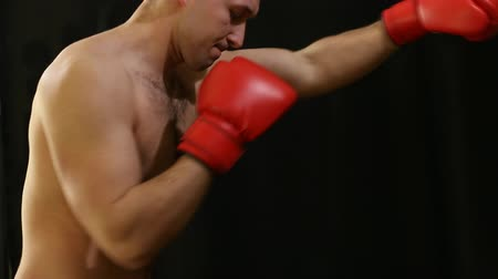 bokszoló : man in red boxing gloves