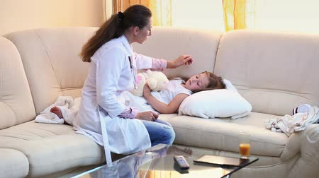paediatrician : Doctor examines a little girl Stock Footage