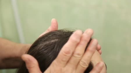 head portrait : Woman doing massage of the head Stock Footage