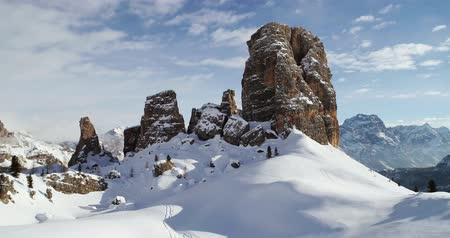 toward : Forward aerial toward majestic Cinque Torri rocky mounts tilting up. Sunny day with cloudy sky.Winter Dolomites Italian Alps mountains outdoor nature establisher.4k drone flight