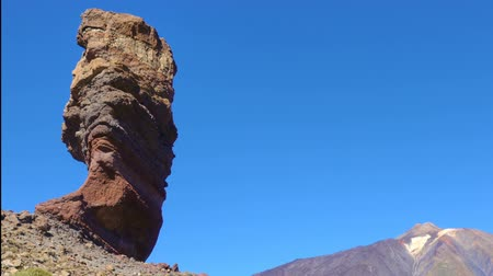 el teide : The Cinchado rock the Teide volcano in Tenerife island, The Canaries. Time lapse. Zoom out Stock Footage