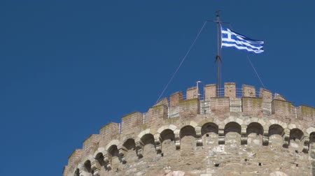 makedonia : Greek flag on the top of the White Tower in Thessaloniki - seamless loop