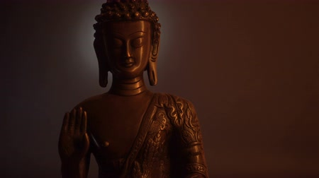 budha : Statuette of Buddha. Moving of the light.