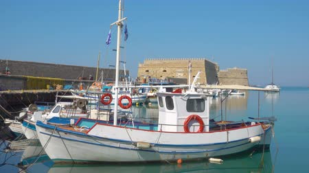 bastião : Venetian Fort in Heraklion and fishing boats, Crete Island, Greece