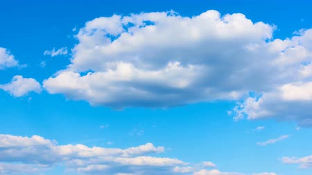 sky only : Blue sky and fast white cumulus clouds - time lapse
