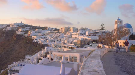 Киклады : THIRA, GREECE - APRIL 23, 2018: Panoramic view of Thira town in Santorini Island at sundown, Greece