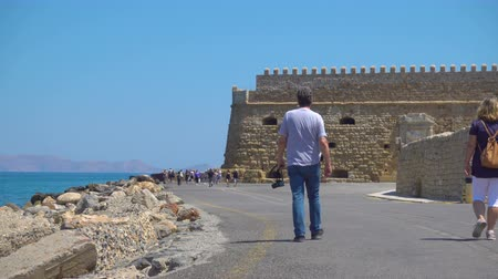 bastião : HERAKLION, GREECE - APRIL 27, 2018: Venetian Fortress in Heraklion and walking people, Crete, Greece