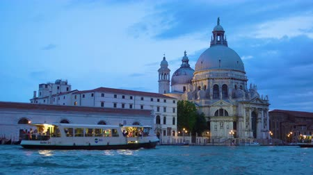 motorbot : Venice, Italy - June 14, 2018: Traffic on The Grand Canal near Santa Maria della Salute church in Venice in the evening