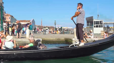 sight seeing : Venice, Italy - June 16, 2018: Gondolas with tourists go single file