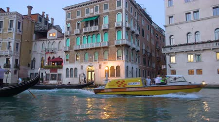 Венеция : Venice, Italy - June 17, 2018: Emergency ambulance boat on the Grand Canal in Venice