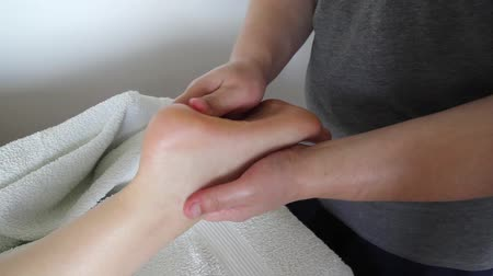 acupressure : Foot massage in beauty salon, close up view. Woman having sports foot massage in spa salon. Male masseur therapist hands doing on female foot massage. Professional masseuse massaging foot of girl.