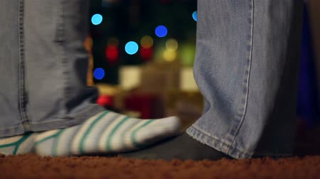 sock : couple in love in front of the Christmas tree Stock Footage