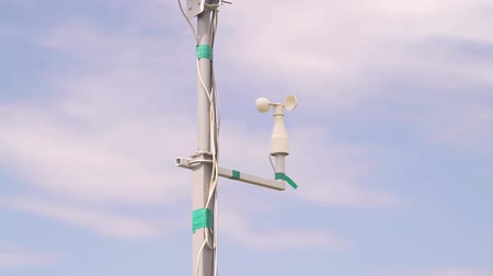 field measurements : Weather station on field of wheat against sky