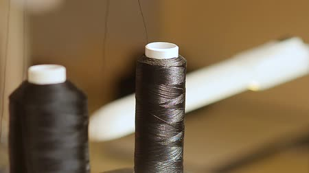přadeno : Coil with Black threads.
