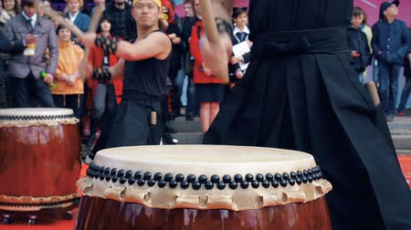 deerskin : Moscow, Russia - April 24, 2016: Hinode Fest in Moscow. Musicians drummers play taiko drums chu-daiko outdoors. Culture folk music of Asia Korea, Japan, China.