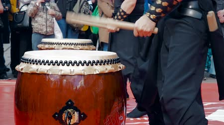 taiko drums : Moscow, Russia - April 24, 2016: Hinode Fest in Moscow. Musicians drummers play taiko drums chu-daiko outdoors. Culture folk music of Asia Korea, Japan, China.