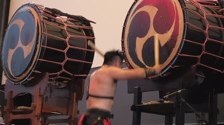 taiko drums : Moscow, Russia - July 16, 2017: Musicians play the big taiko drum on scene During the japanese festival. Stock Footage