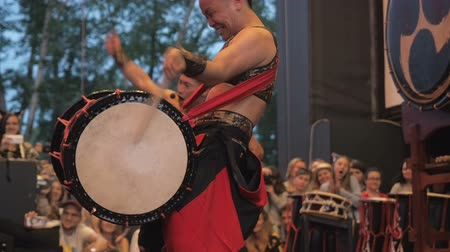 taiko drums : Moscow, Russia - July 16, 2017: Japanese musician expressively play the taiko drums on scene During the japanese festival