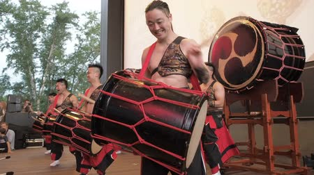 taiko drums : Moscow, Russia - July 16, 2017: Musicians play the taiko drums on scene During the japanese festival. Stock Footage