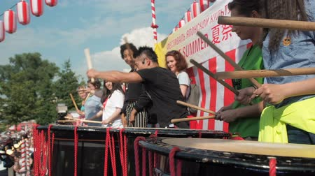 taiko drums : Moscow, Russia - July 16, 2017: Japanese artist teaches children to play on the taiko drums on scene During the japanese festival