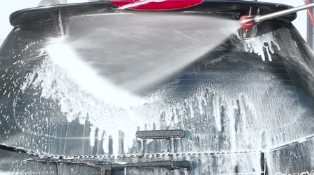 trigger : MOSCOW, RUSSIA MARCH 25, 2019: Car Washing Process on a Self-Service Car Wash. A Jet of Water With a High Pressure Wash Off the Foam From the Car Rear Window