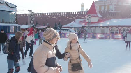камедь : Moscow, Russia - January 27, 2019: Muscovites and city guests ride on the most famous ice rink in the center of Moscow. Panorama of GUM rink on Red square. The main skating rink on Red Square in Winter Holiday. Slow Motion Video