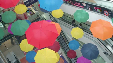 Pyatigorsk, Russia - August 30, 2019: Many bright colored umbrellas suspend in shopping center Gallery. Beautiful multi-colored umbrellas hanging in a mall top view. Colorful abstract background