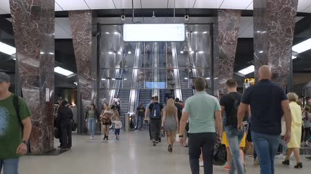 hurry up : Moscow, Russia - September 11, 2019: People go up and go down to the underground subway. Modern metro station and hurrying people of the big city. Contemporary subway station. The movement of diversity people in the subway