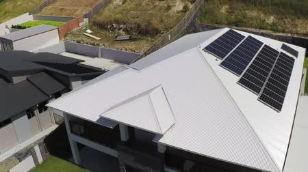 e : Aerial view of modern new luxury home with solar panels
