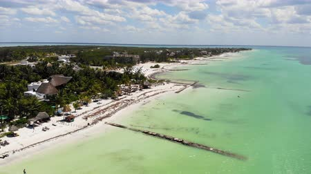 Aerial shot of Isla Holbox beachfront resorts on a sunny day, Mexico