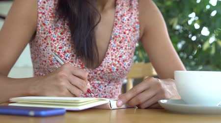 Woman write in diary