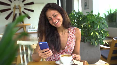 Young woman use smartphone and smile. Chatting with boyfriend