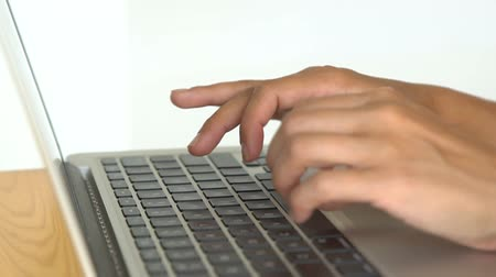 Womens hands typing on computer keyboard