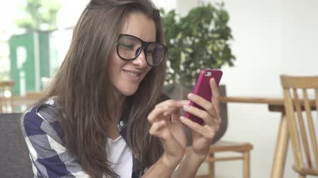Woman look through pictures on smartphone