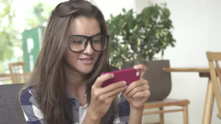 Young businesswoman play game on cell phone