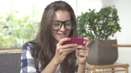 Young female play game on mobile phone