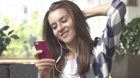 Girl listen to music on smartphone with headphones. Vídeos