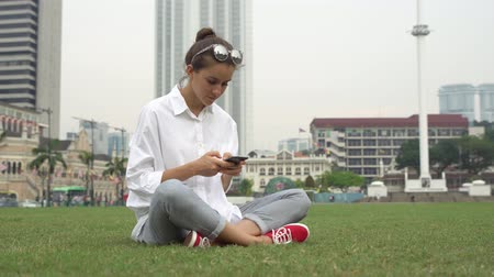 Young businesswoman work on smartphone, write message