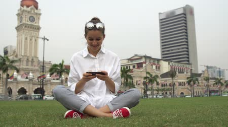 Young businesswoman work on cell phone, writing message