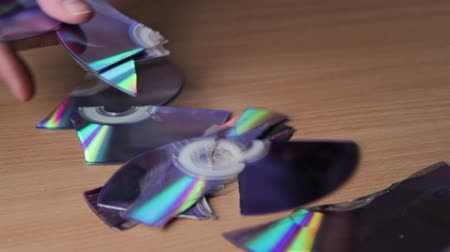 duplication : Pieces of broken CD DVD on table