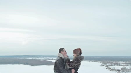társkereső : Young couple kissing by the river in winter weather, HD