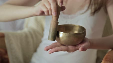 miska : Young beautiful lady relaxing with nepal singing bowl, HD