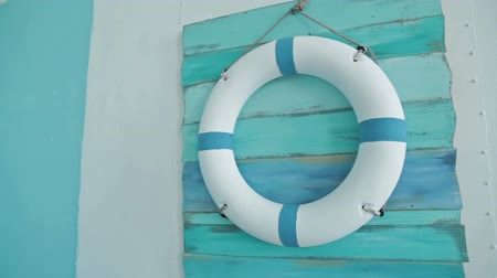 lifebelt : Life buoy on board on it hanging on blue wall, HD Stock Footage