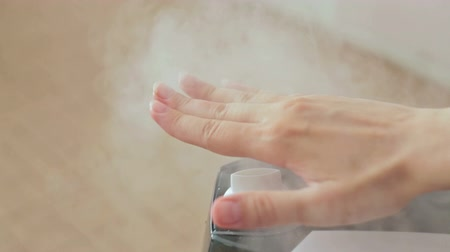 ionizing : Steam of humidifier and womans hand