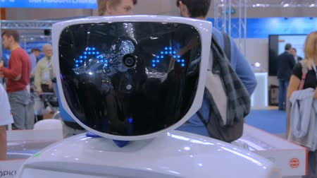 intelligencia : MOSCOW, RUSSIA - SEPTEMBER 8, 2017: City of Education Exhibition. White robot with blue eyes at technology exhibition. Future and robotic concept