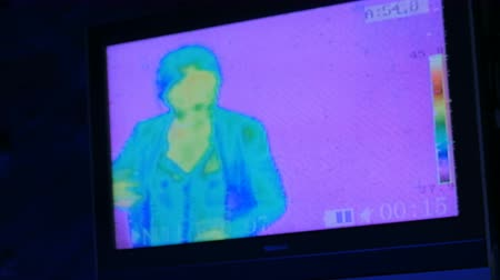 infra : Thermographic camera view of woman. Blue, green, yellow colors show different temperatures